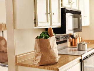 paper grocery bag of freshly bought food from store