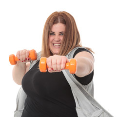 Overweight woman exercising with dumbbells