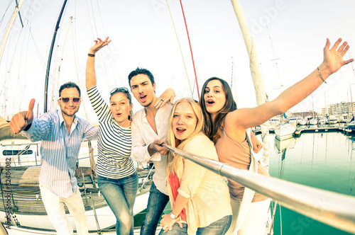 Best friends using selfie stick taking pic on luxury sail boat - 82484082