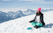 Beautiful young woman doing yoga in the snow mountain
