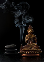 Buddha statue and stones zen. Spa and meditation concept