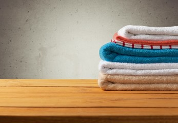 Bathroom. Retro background with fresh towels on wooden table
