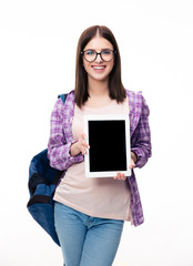 Smiling woman showing tablet computer screen