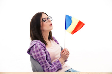 Young woman blowing on the french flag