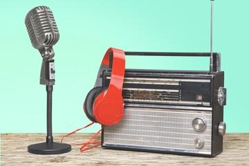 Recorder. Reel to reel recorder, red microphone, headphones in