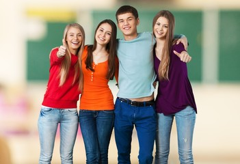 Teenager. Four College Students Celebrating on White