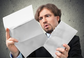Shock. Man Opens Letter with Shocked Expression