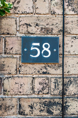 House number fifty eight for use as a background