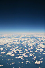 view from aeroplane on white clouds