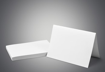 Card. Blank business cards on grey background