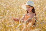 girl looking of wheat's spica