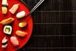 Mixed sushi platter with chopsticks - 82515057