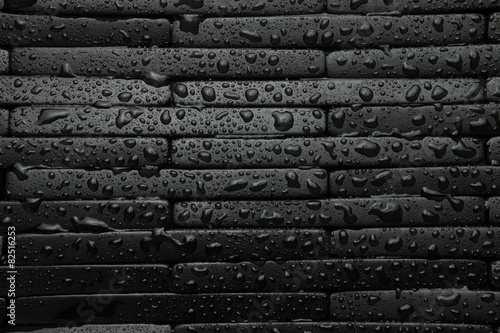 Black tile background with water - 82516253