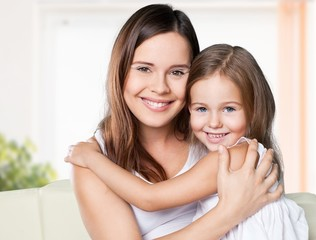 Fun. Happy family. Mother and baby daughter plays at home on the