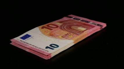 Stack of 10 Euro bills turning