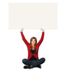 Holding. Female sitting on floor as she holds up a billboard