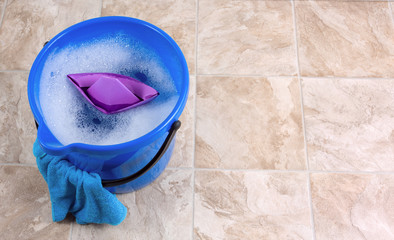 Image of a bucket with rag and water for cleaning