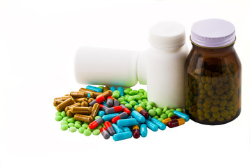 colorful pills and tablets on white background