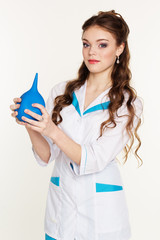 Young nurse with blue lavement in hands