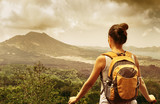 woman traveler looking at Batur volcano. Bali,Indonesia