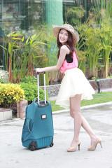 Asian women travellers prepare bag
