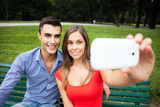 Couple taking a selfie portrait