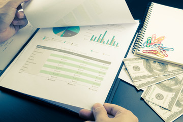 Man Analysis Business and financial report.money