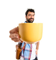 Tourist holding a cup of coffee