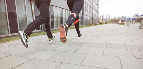 Close up of two runners in the city