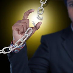 Business man with broken chain