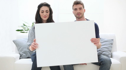 Couple Holding Placard