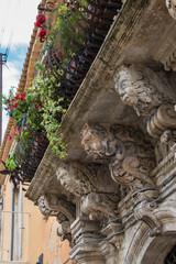 Baroque balcony in Syracuse, Sicily, Italy