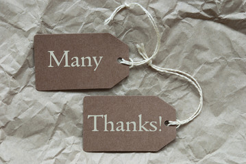 Two Brown Labels With Many Thanks Paper Background