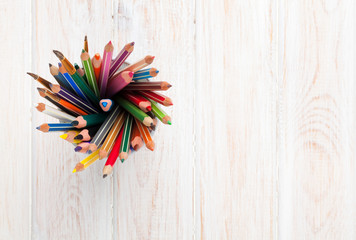 Office desk table with colorful pencils