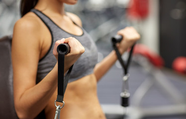 close up of woman exercising on gym machine