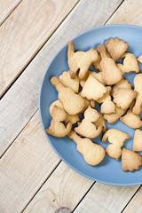 Grey plate with tasty cookies in the form of figurines of cats