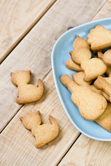 Blue plate with tasty cookies in the form of figurines of cats