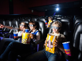 Siblings Having Snacks In 3D Movie Theater