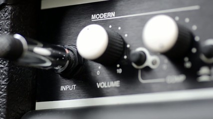 Inserting a Cable into a Guitar Amp