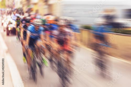 Deurstickers Fietsen Bikers during bike race on city street, defocussing effect