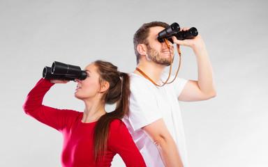 Couple looking through binoculars