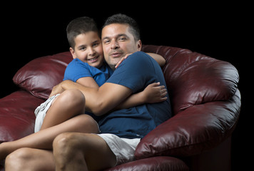 Cute Boy and His Father Having Fun at Sofa
