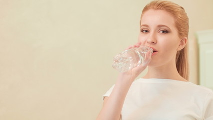 Young woman drinking water Concept of healthy lifestyle