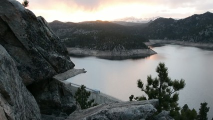 A beautiful pristine mountain reservoir at sunset