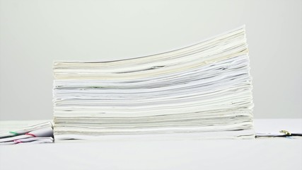 Stack old overload paperwork on table time lapse