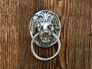 old door handle in form of lion muzzle