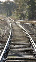 A Railway Train Track Disappearing into the Distance.
