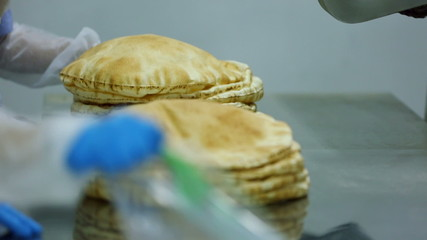 At the bakery, Workers package bread