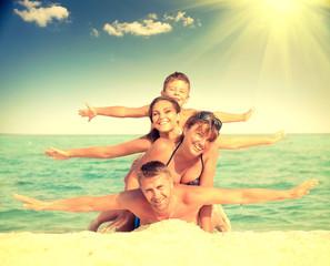 Happy family having fun at the beach. Joyful family