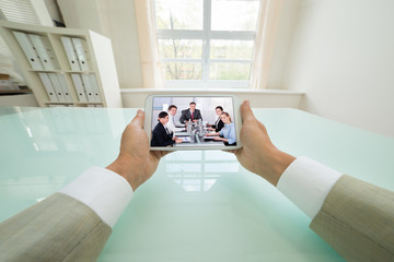 Businessman Video Chatting With Colleagues